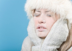 Frozen. Chilled female face covered in snow ice
